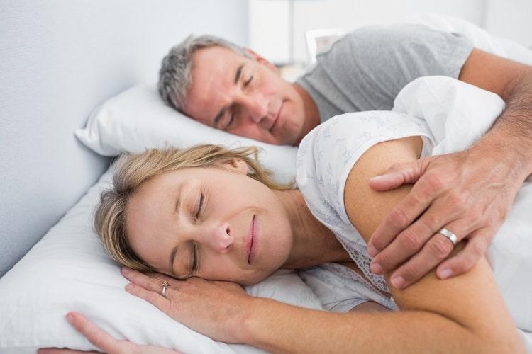 A couple sleeping soundly after Sleep Apnea treatment