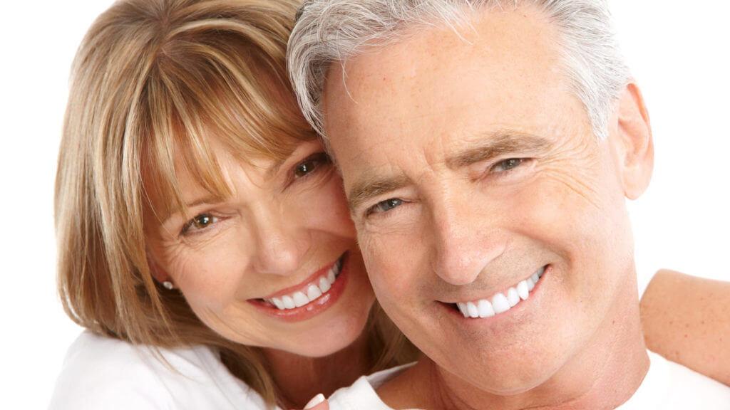 An older couple enjoying the benefits of restorative dentistry