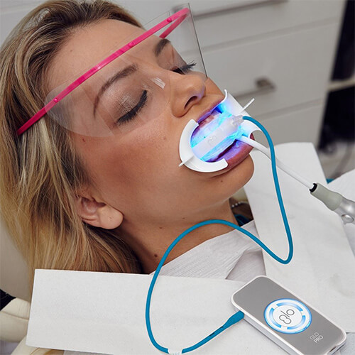 A female patient getting her teeth whitened at Bay Breeze Dentistry